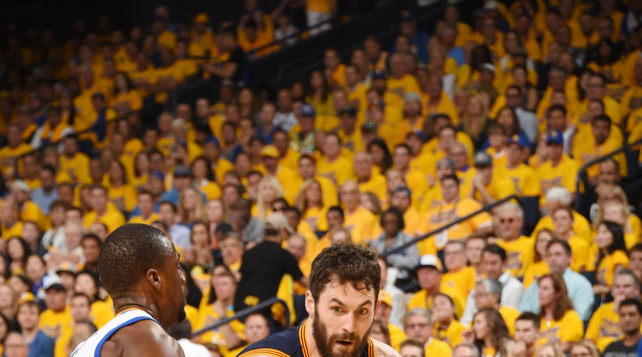 OAKLAND, CA - JUNE 5:  Kevin Love #0 of the Cleveland Cavaliers handles the ball against the Golden State Warriors in Game Two of the 2016 NBA Finals on June 5, 2016 at ORACLE Arena in Oakland, California. (Photo by Andrew D. Bernstein/NBAE via Getty Imag
