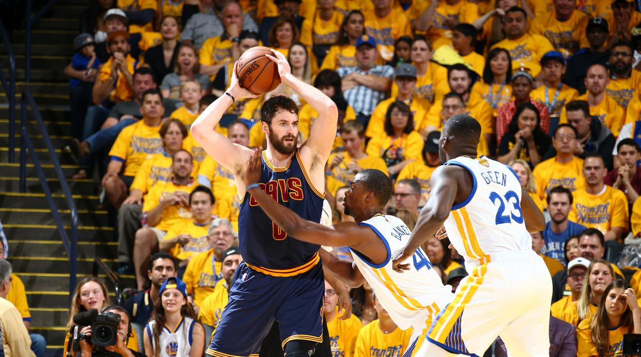 OAKLAND, CA - JUNE 5:  Kevin Love #0 of the Cleveland Cavaliers handles the ball against Harrison Barnes #40 of the Golden State Warriors in Game Two of the 2016 NBA Finals on June 5, 2016 at Oracle Arena in Oakland, California. (Photo by Nathaniel S. But