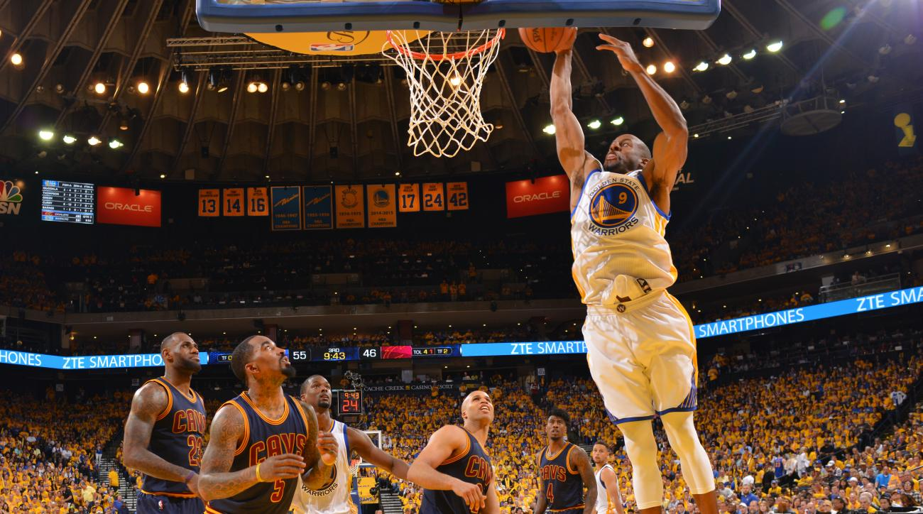 OAKLAND, CA - JUNE 5:  Andre Iguodala #9 of the Golden State Warriors dunks the ball against the Cleveland Cavaliers during the 2016 NBA Finals Game One on June5, 2016 at ORACLE Arena in Oakland, California. (Photo by Jesse D. Garrabrant/NBAE via Getty Im