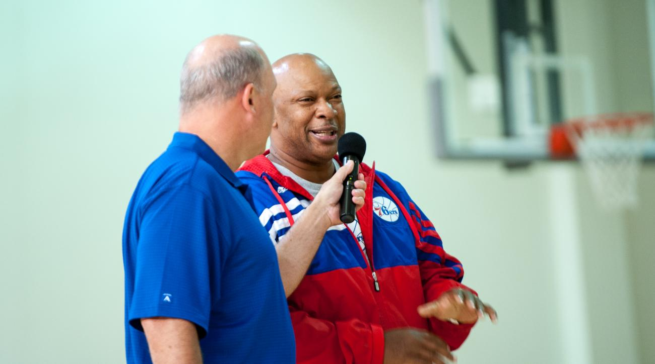 TRENTON, NJ - NOVEMBER 4: Sean Rooks Assistant Coach for Player Development speaks to Flight Squad members during a Philadelphia 76ers practice on November 4, 2014 at the Fort Dix Military Base in Trenton, New Jersey. (Photo by Jeremy Messler/NBAE via Get