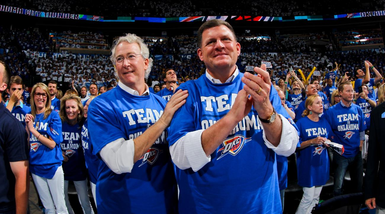 OKLAHOMA CITY, OK - MAY 16: Oklahoma City Thunder majority owner Clay Bennett, right, and minority owner Aubrey McClendon cheer their team on against the Los Angeles Lakers in Game Two of the Western Conference Semifinals during the 2012 NBA Playoffs on M