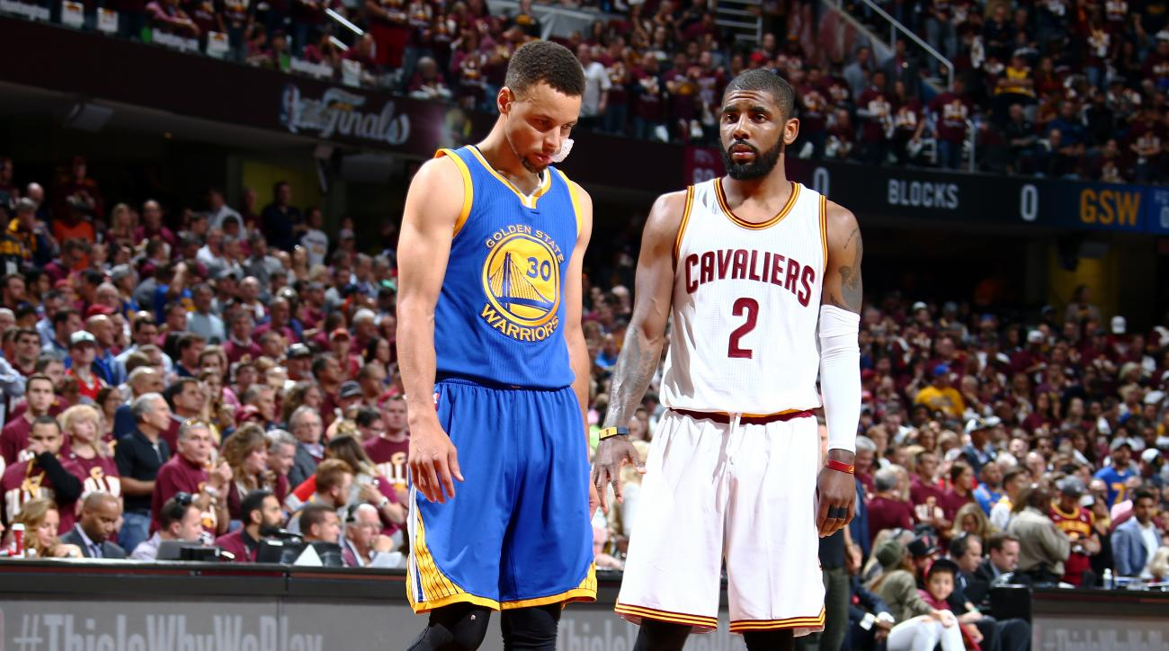 CLEVELAND, OH - JUNE 8: Kyrie Irving #2 of the Cleveland Cavaliers and Stephen Curry #30 of the Golden State Warriors looks on during the game during the 2016 NBA Finals Game Three on June 8, 2016 at Quicken Loans Arena in Cleveland, Ohio.  (Photo by Nath