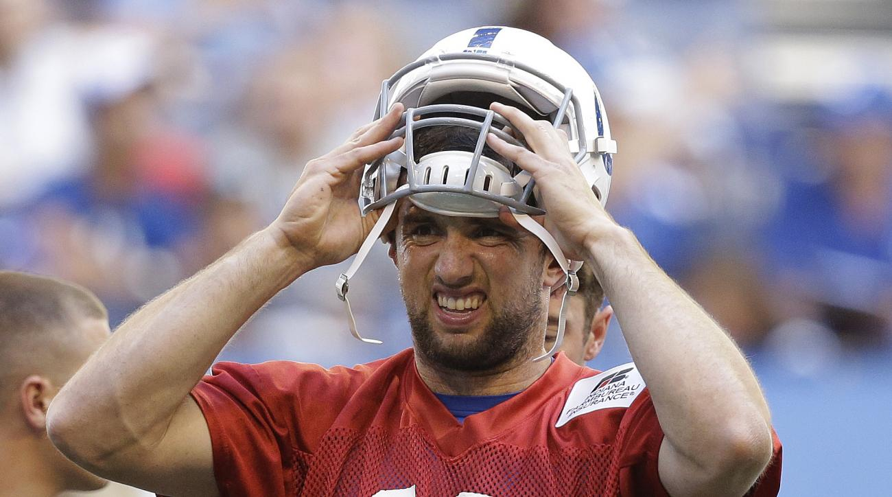 Indianapolis Colts' Andrew Luck puts on his helmet during an NFL football practice, Wednesday, June 8, 2016, in Indianapolis. (AP Photo/Darron Cummings)