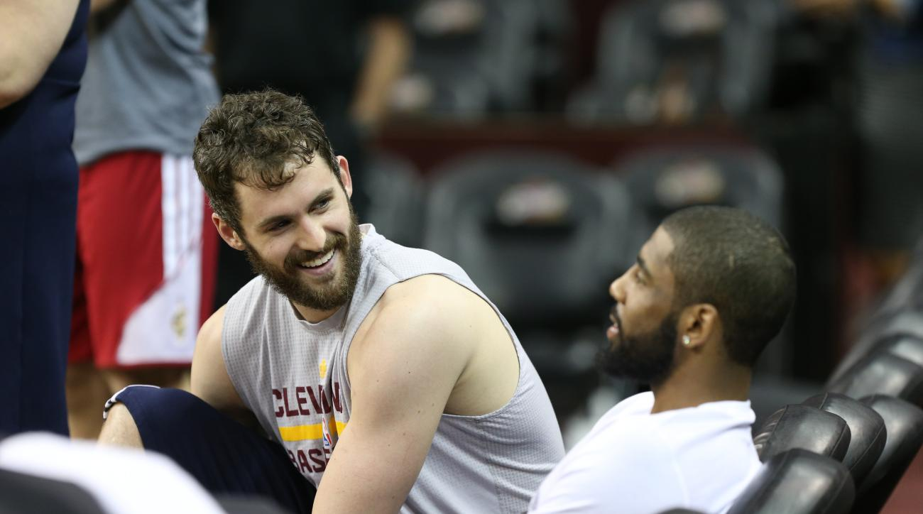 CLEVELAND, OH - JUNE 9 :  Kevin Love #0 talks with Kyrie Irving #2 of the Cleveland Cavaliers during practice and media availability as part of the 2016 NBA Finals on June 9, 2016 at Quicken Loans Arena in Cleveland, Ohio. (Photo by Joe Murphy/NBAE via Ge