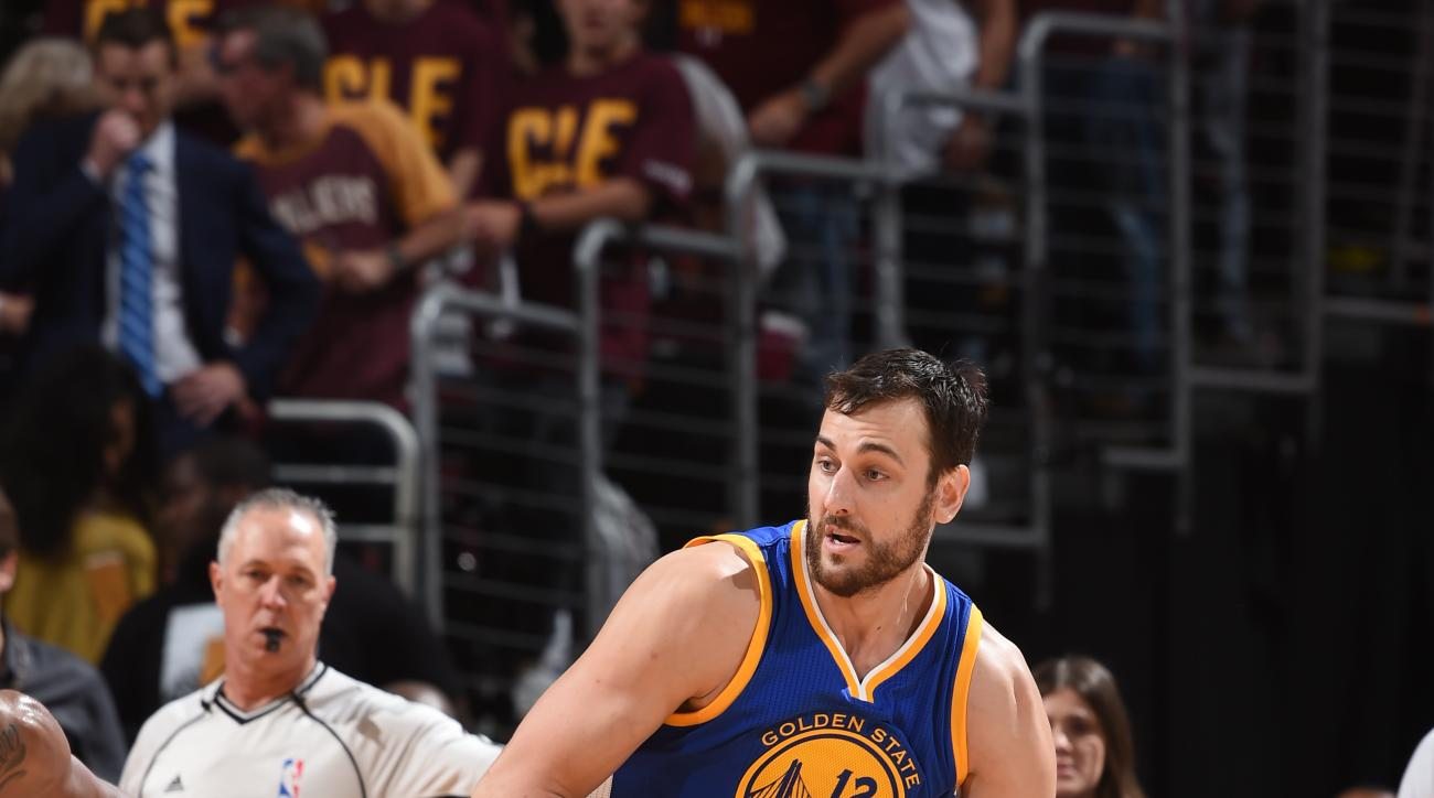 CLEVELAND, OH  - JUNE 10: Andrew Bogut #12 of the Golden State Warriors handles the ball against the Cleveland Cavaliers during Game Four of the 2016 NBA Finals at The Quicken Loans Arena on June 10, 2016 in Cleveland, Ohio. (Photo by Andrew D. Bernstein/