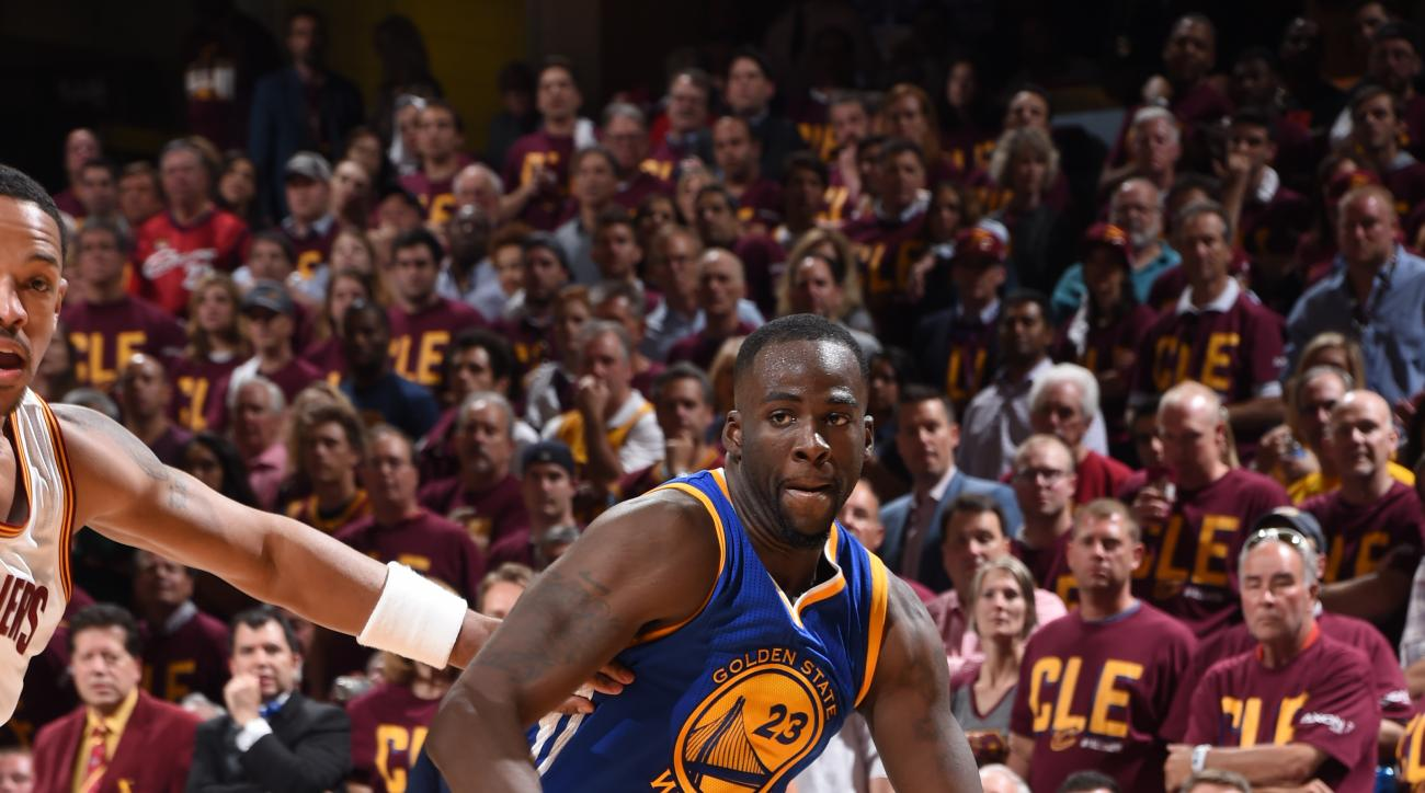 CLEVELAND, OH  - JUNE 10: Draymond Green #23 of the Golden State Warriors handles the ball against the Cleveland Cavaliers during Game Four of the 2016 NBA Finals at The Quicken Loans Arena on June 10, 2016 in Cleveland, Ohio. (Photo by Andrew D. Bernstei