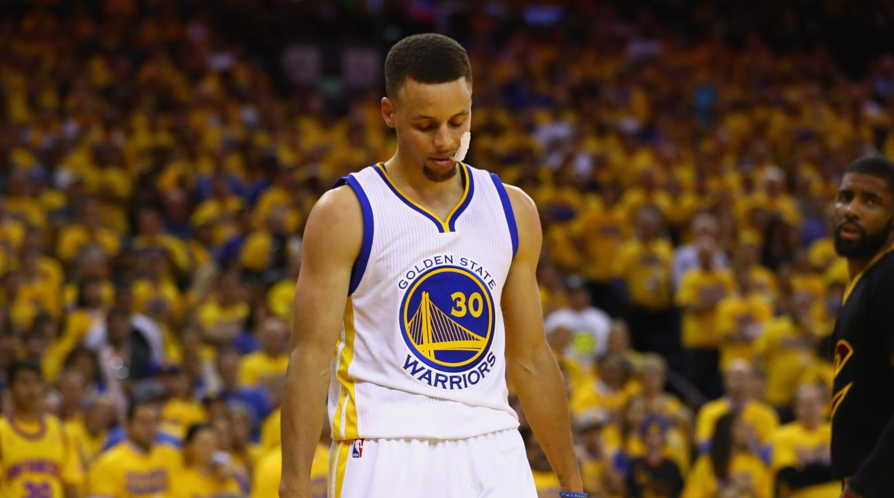 OAKLAND, CA - JUNE 13:  Stephen Curry #30 of the Golden State Warriors reacts during the second half against the Cleveland Cavaliers in Game 5 of the 2016 NBA Finals at ORACLE Arena on June 13, 2016 in Oakland, California. (Photo by Ezra Shaw/Getty Images