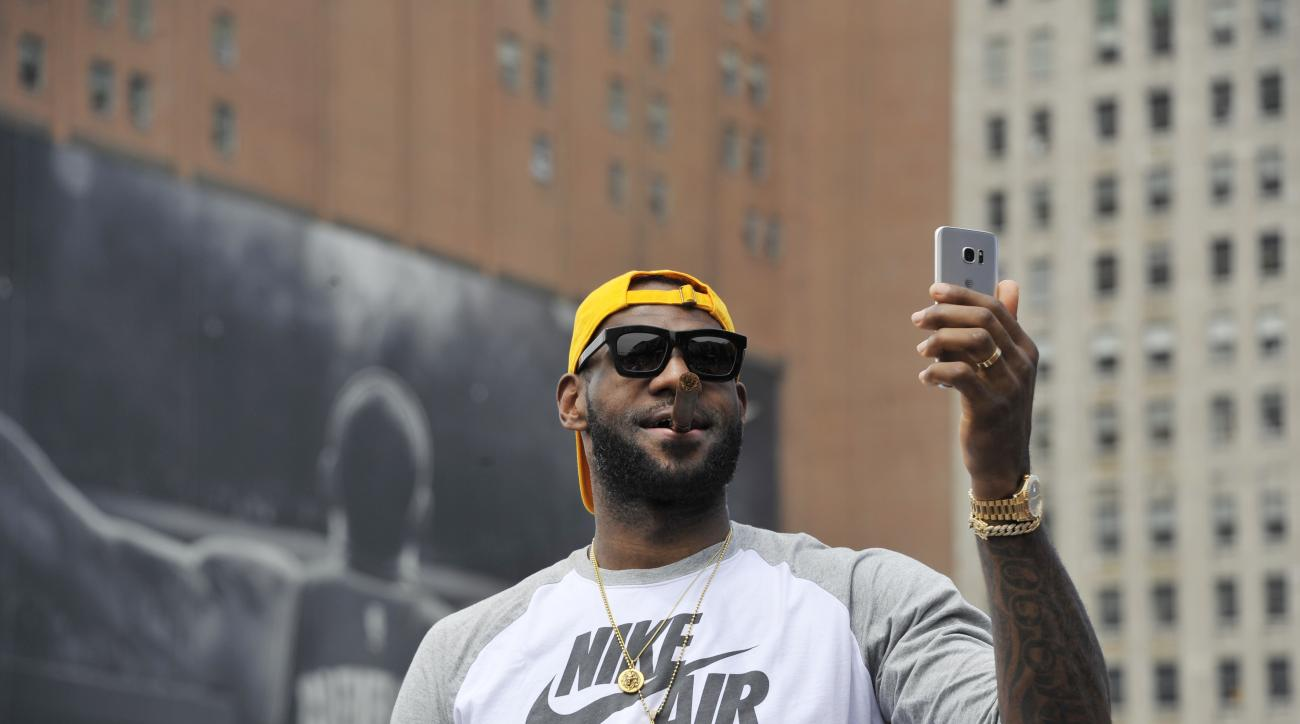 CLEVELAND, OH - JUNE 22:  LeBron James #23 of the Cleveland Cavaliers waves to the fans during the Cleveland Cavaliers Victory Parade And Rally on June 22, 2016 in downtown Cleveland, Ohio.  (Photo by David Liam Kyle/NBAE/Getty Images)