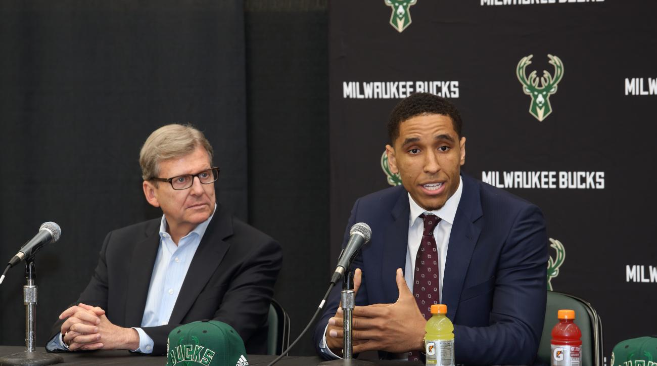 ST. FRANCIS, WI - JUNE 24: Milwaukee Bucks general manager John Hammond and draft pick Malcolm Brogdon participate in a press conference at the Orthopaedic Hospital of Wisconsin Training Center on June 24, 2016  in St. Francis, Wisconsin. (Photo by Gary D