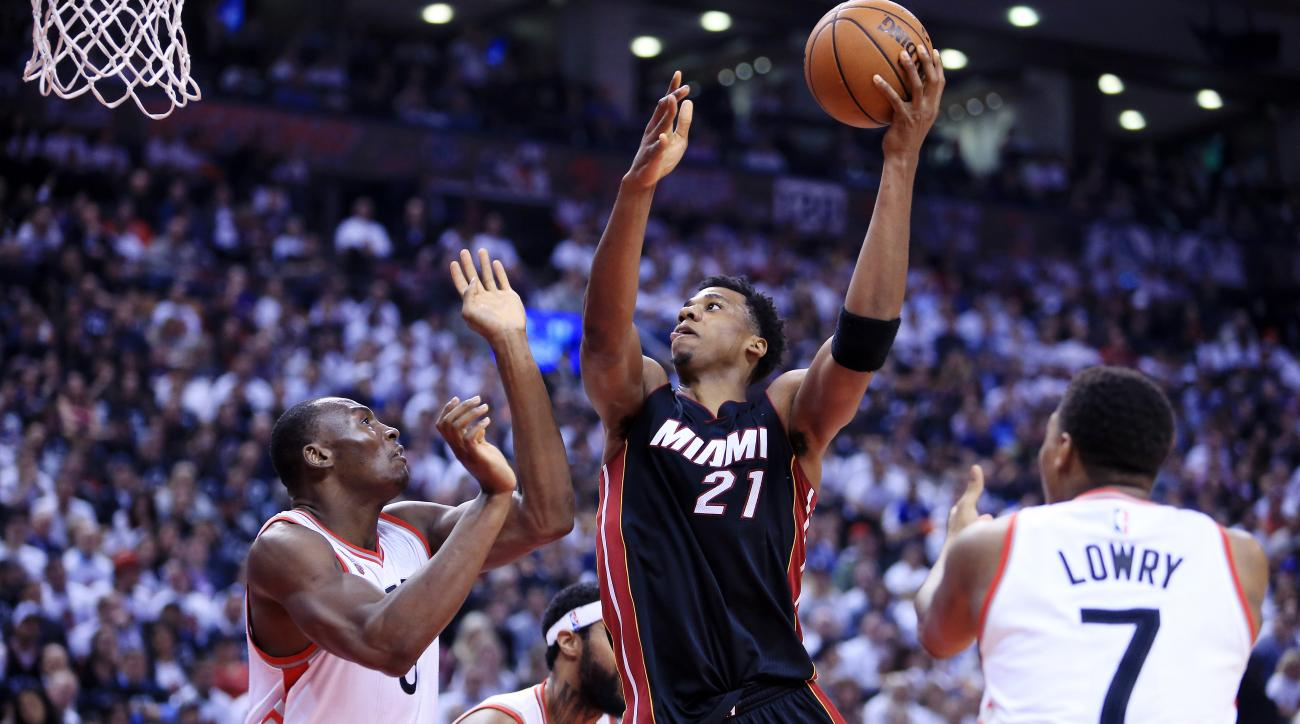 TORONTO, ON - MAY 05:  Hassan Whiteside #21 of the Miami Heat shoots the ball as Bismack Biyombo #8 of the Toronto Raptors defends in the second half of Game Two of the Eastern Conference Semifinals during the 2016 NBA Playoffs at the Air Canada Centre on