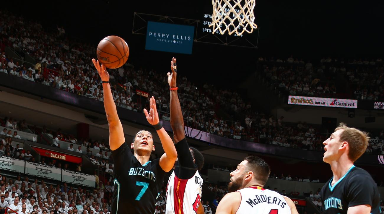 MIAMI, FL - MAY 1:   Jeremy Lin #7 of the Charlotte Hornets shoots the ball against the Miami Heat during Game Seven of the Eastern Conference Quarterfinals during the 2016 NBA Playoffs on May 1, 2016 at American Airlines Arena in Miami, Florida. NOTE TO