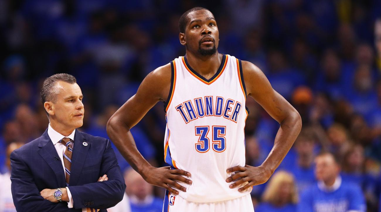 FILE - JULY 04: Oklahoma City Thunder free agent Kevin Durant announced that he will sign a reportedly two-year, $54 million contract with the Golden State Warriors. OKLAHOMA CITY, OK - MAY 28:  Head coach Billy Donovan of the Oklahoma City Thunder talks