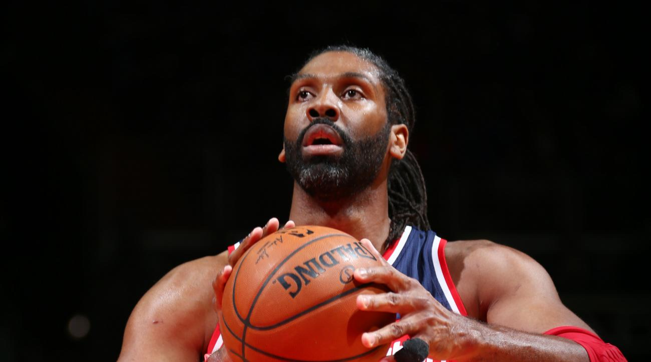 WASHINGTON, DC - APRIL 10:  Nene #42 of the Washington Wizards shoots a free throw against the Charlotte Hornets on April 10, 2016 at Verizon Center in Washington, DC. (Photo by Ned Dishman/NBAE via Getty Images)