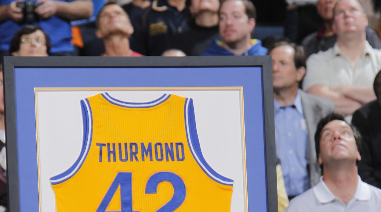 OAKLAND, CA - MARCH 19: Former Golden State Warriors player Nate Thurmond attends Chris Mullin's jersey retirement ceremony during a game between the Minnesota Timberwolves and the Golden State Warriors on March 19, 2012 at Oracle Arena in Oakland, Califo