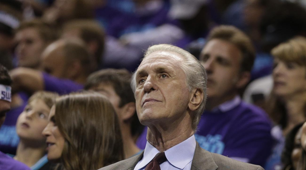 FILE - This April 29, 2016 file photo shows Miami Heat president Pat Riley watching the action during the second half in Game 6 of an NBA basketball playoffs first-round series against the Charlotte Hornets in Charlotte, N.C. Hassan Whiteside is going to