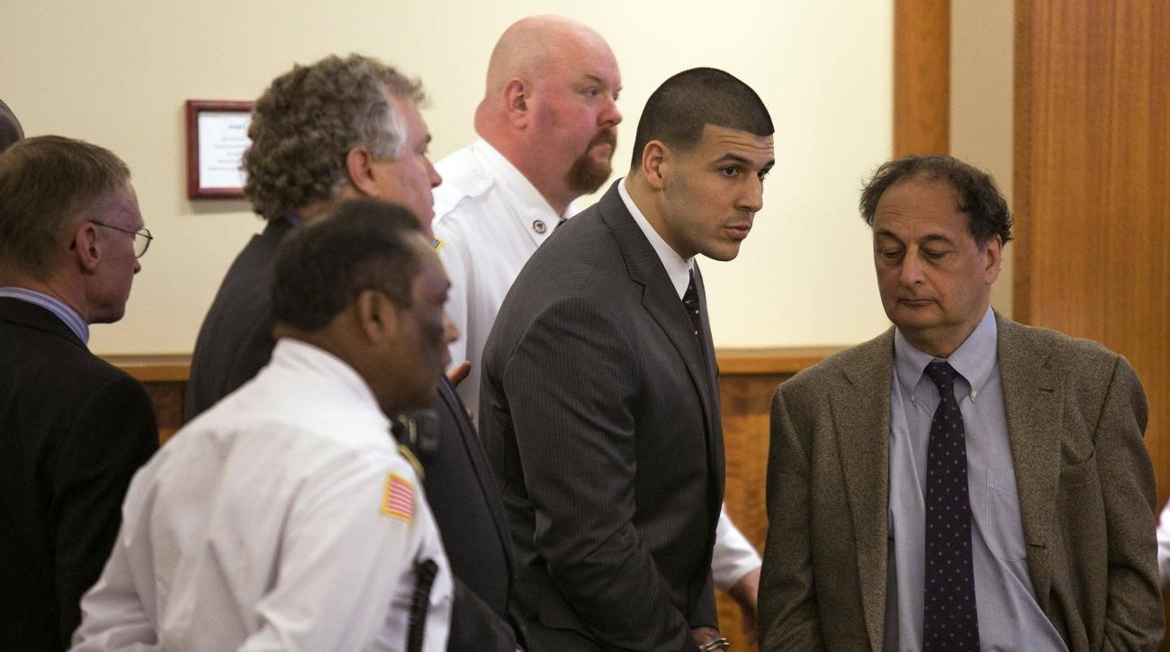 Former New England Patriots football player Aaron Hernandez stands up after he is sentenced to life in prison at his murder trial at the Bristol County Superior Court in Fall River, Mass., on Wednesday, April 15, 2015.  Hernandez was found guilty of first