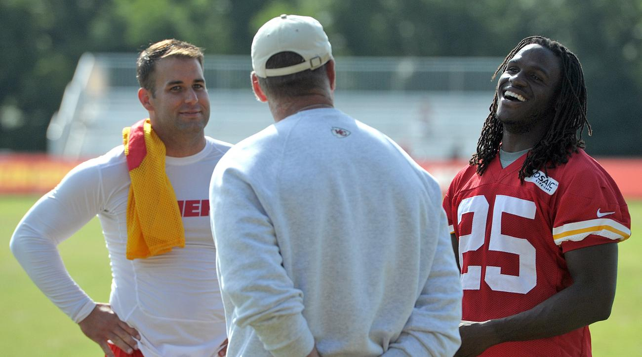 FILE - In this Aug. 14, 2014, file photo, Kansas City Chiefs quarterback Chase Daniel, left,  and Jamaal Charles, right,  chat with general manager John Dorsey following NFL football training camp in St. Joseph. Mo. If Chiefs general manager John Dorsey i