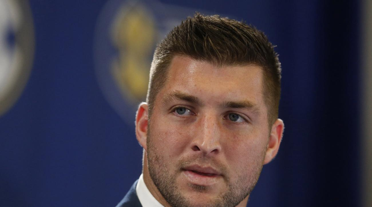 FILE - In this Dec. 5, 2014, file photo, Tim Tebow speaks during an SEC television broadcast in Atlanta. Tebow is expected to sign a one-year contract with the Philadelphia Eagles on Monday, April 20, 2015 according to three people familiar with the deal.
