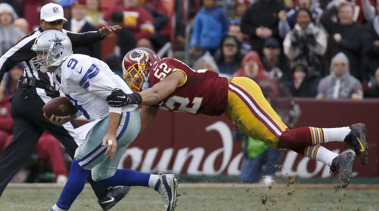In this photo taken Dec. 28, 2014, Dallas Cowboys quarterback Tony Romo (9) is sacked by Washington Redskins inside linebacker Keenan Robinson (52) during the first half of an NFL football game in Landover, Md. Robinson came away expecting good things aft