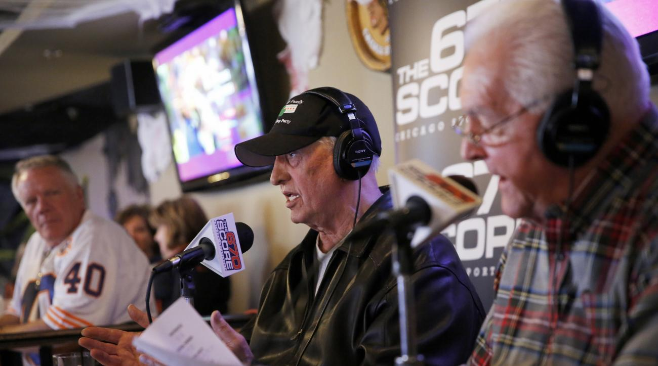 In an Oct. 26, 2014, photo former Chicago Bears   Doug Buffone, and Ed O'Bradovich, right foreground, talk about the Bears 51-23 loss to the New England Patriots  during their post-game radio show at Durbin's in Tinley Park, Ill. Buffone has been found de