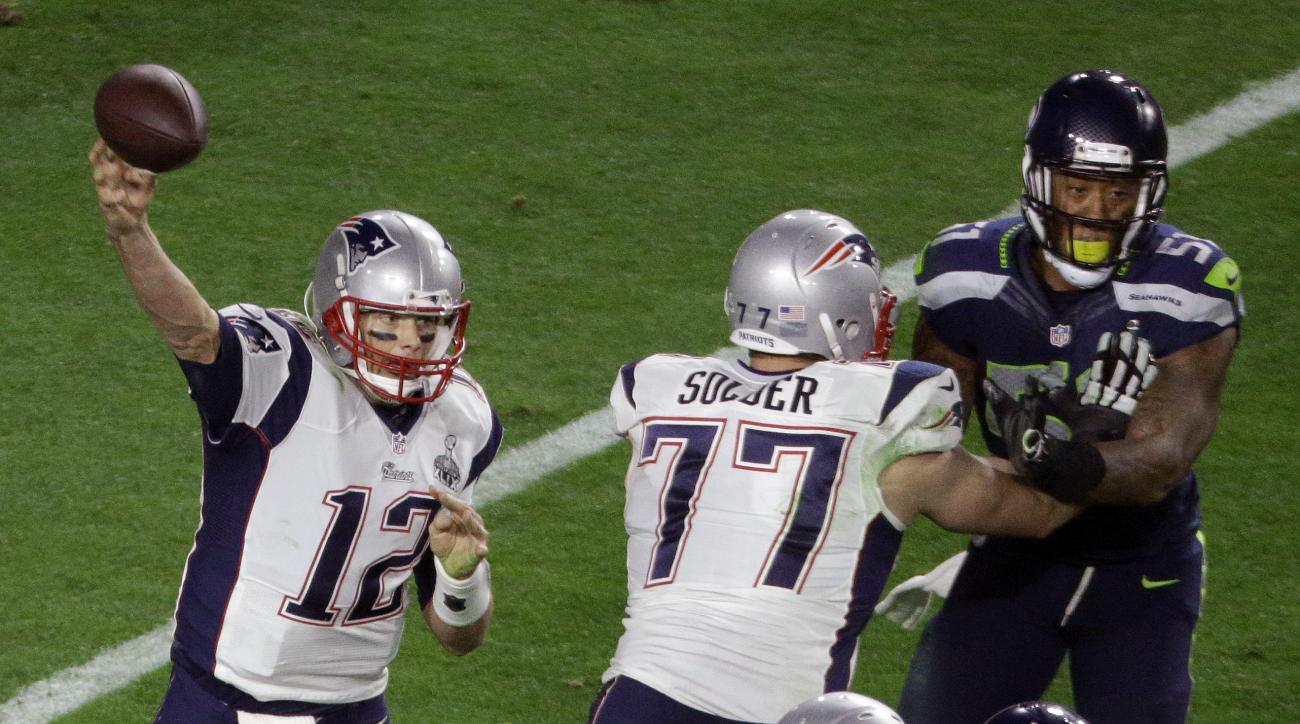 New England Patriots quarterback Tom Brady (12) passes behind tackle Nate Solder (77) blocking Seattle Seahawks outside linebacker Bruce Irvin (51) during the second half of NFL Super Bowl XLIX football game Sunday, Feb. 1, 2015, in Glendale, Ariz. (AP Ph
