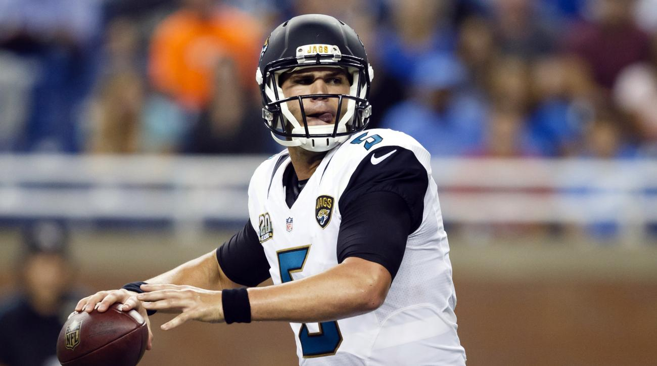 FILE - In this Aug. 22, 2014, file phot, Jacksonville Jaguars quarterback Blake Bortles looks to throw a pass against the Detroit Lions during a preseason NFL football game at Ford Field in Detroit. Bortles spent more than two months in California during