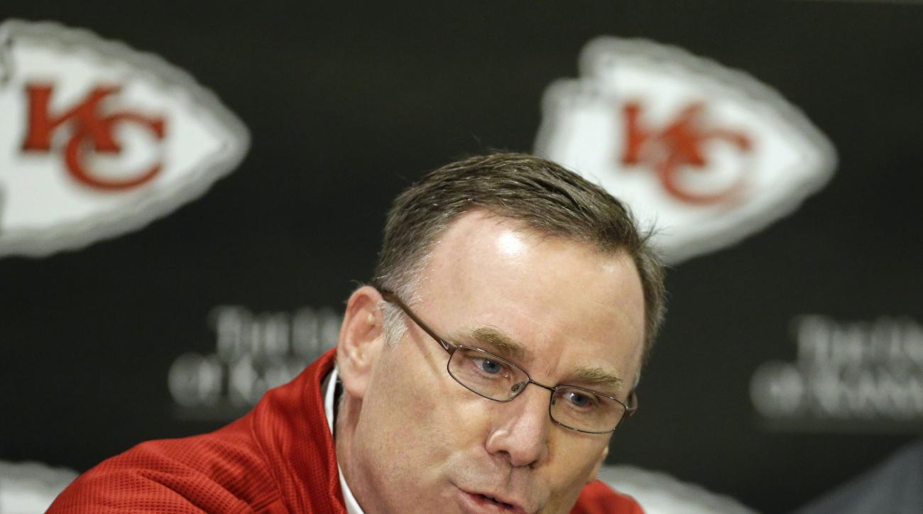 FILE - In this March 13, 2013, file phot,o Kansas City Chiefs general manager John Dorsey speaks during an NFL football news conference at the team's practice facility in Kansas City, Mo. The first few year Dorsey was in charge of the Chiefs, he was hampe
