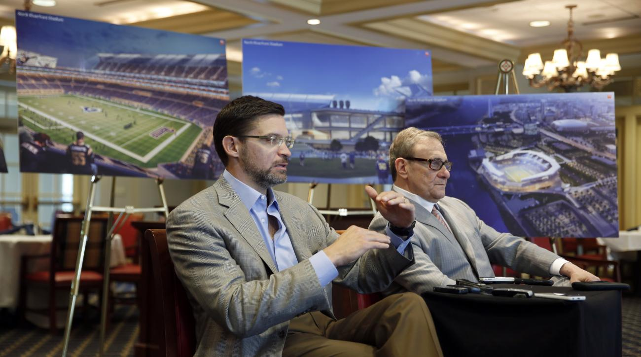 With artist's renderings as a backdrop, Dave Peacock, left, and Bob Blitz, leaders in the effort to build a new NFL stadium in St. Louis, speak with the media Friday, April 24, 2015, in St. Louis, two days after making a presentation to the league  The pa