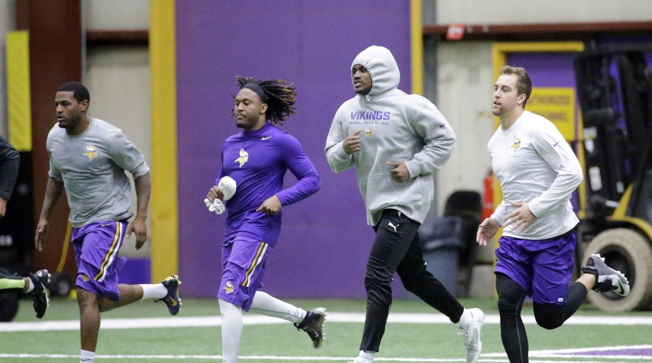 Minnesota Vikings wide receivers, from left,  Mike Wallace, Jarius Wright,  Cordarrelle Patterson and Adam Thielen take part in an NFL offseason player workout in Eden Prairie, Minn., Monday, April 27, 2015. (AP Photo/Ann Heisenfelt)