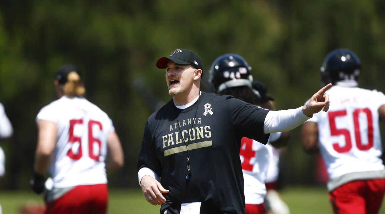 Atlanta Falcons head coach Dan Quinn direct his team during an NFL football minicamp practice  Tuesday, April 28, 2015, in Flowery Branch, Ga. The workout was Quinn's first as head coach. (AP Photo/John Bazemore)