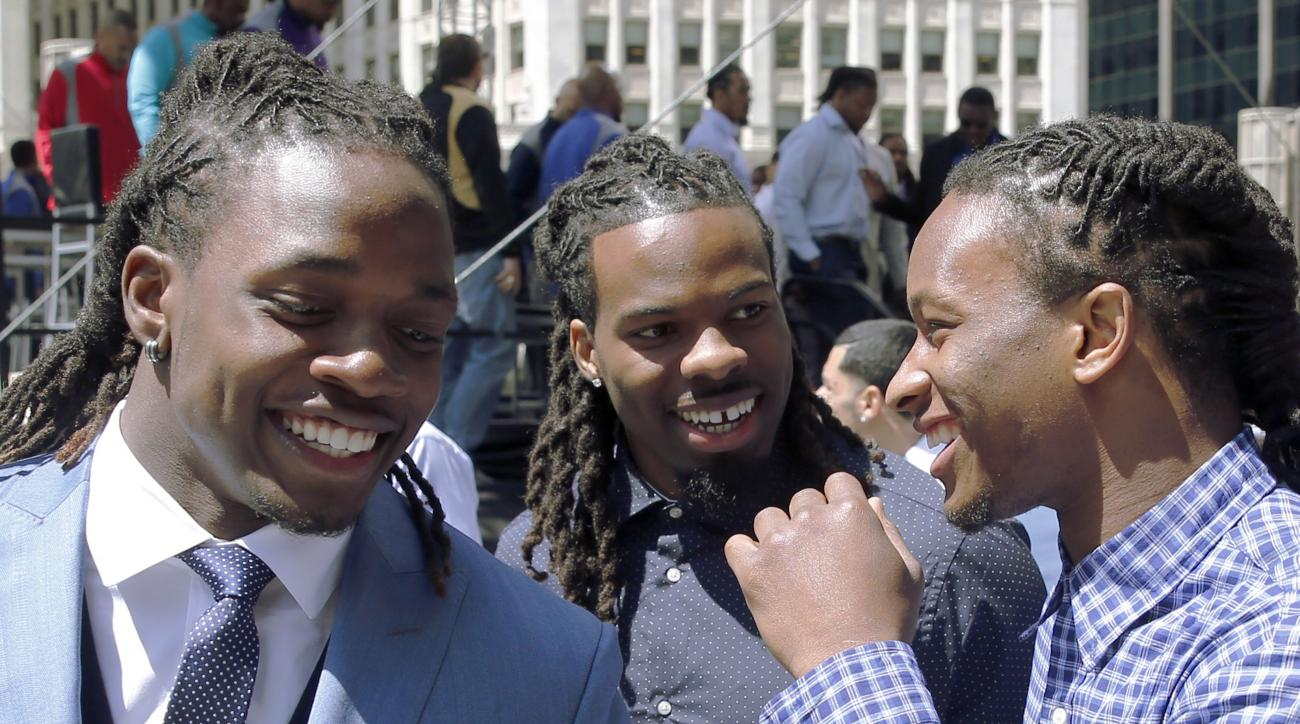 Wisconsin running back Melvin Gordon, left, West Virginia wide receiver, Kevin White, center, and Georgia running back Todd Gurley laugh after introductions at a pre-draft rally of 2015 NFL Draft prospects, and various league legends at Pioneer Court Wedn