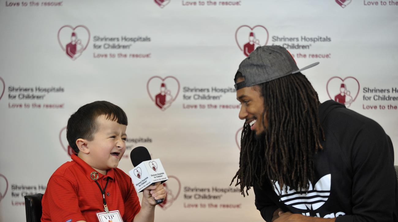 NFL prospect Trae Waynes of Michigan State talks to pediatric patient Alec Cabacungan while doing a mock interview during the NFL PLAY 60 activities at Shriners Hospital for Children Thursday, April 30, 2015, in Chicago. (AP Photo/Paul Beaty)
