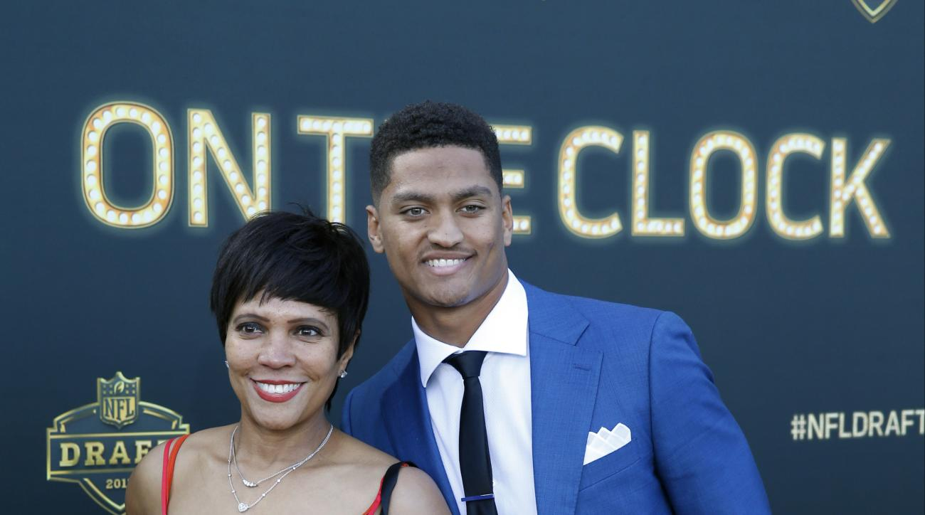 Wake Forest defensive back Kevin Johnson poses for photos his mother Judy Johnson, upon arriving for the first round of the 2015 NFL Football Draft at the Auditorium Theater of Roosevelt University, Thursday, April 30, 2015, in Chicago. (AP Photo/Charles