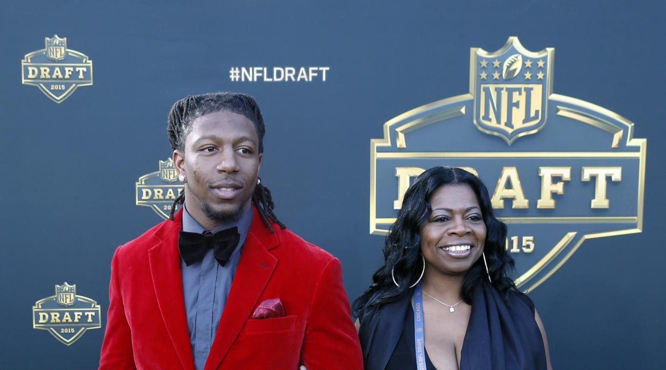 Kentucky linebacker Bud Dupree poses for photos his mother Sophia Stephens, upon arriving for the first round of the 2015 NFL Football Draft at the Auditorium Theater of Roosevelt University, Thursday, April 30, 2015, in Chicago. (AP Photo/Charles Rex Arb