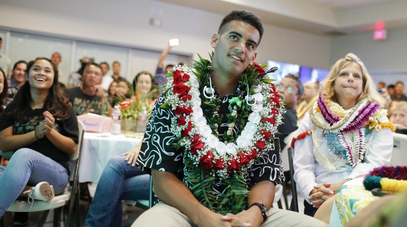 Former Oregon quarterback Marcus Mariota, center, looks on with his mother Alana Deppe-Mariota, right, waiting for the NFL Draft to start at the Saint Louis Alumni Clubhouse on NFL Draft Day Thursday, April 30, 2015, in Honolulu. (Thomas Boyd/The Oregonia