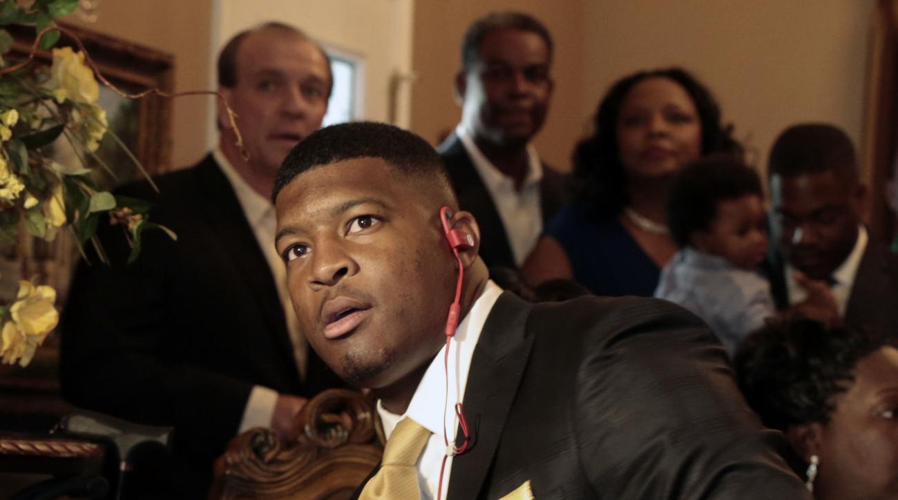Jameis Winston takes the call from Tampa Bay Buccaneers, Thursday, April 30, 2015, in Bessemer, Ala. The Bucs put an end to months of speculation by selecting the talented-but-troubled signal caller, who won the Heisman Trophy in 2013. (AP Photo/Butch Dil