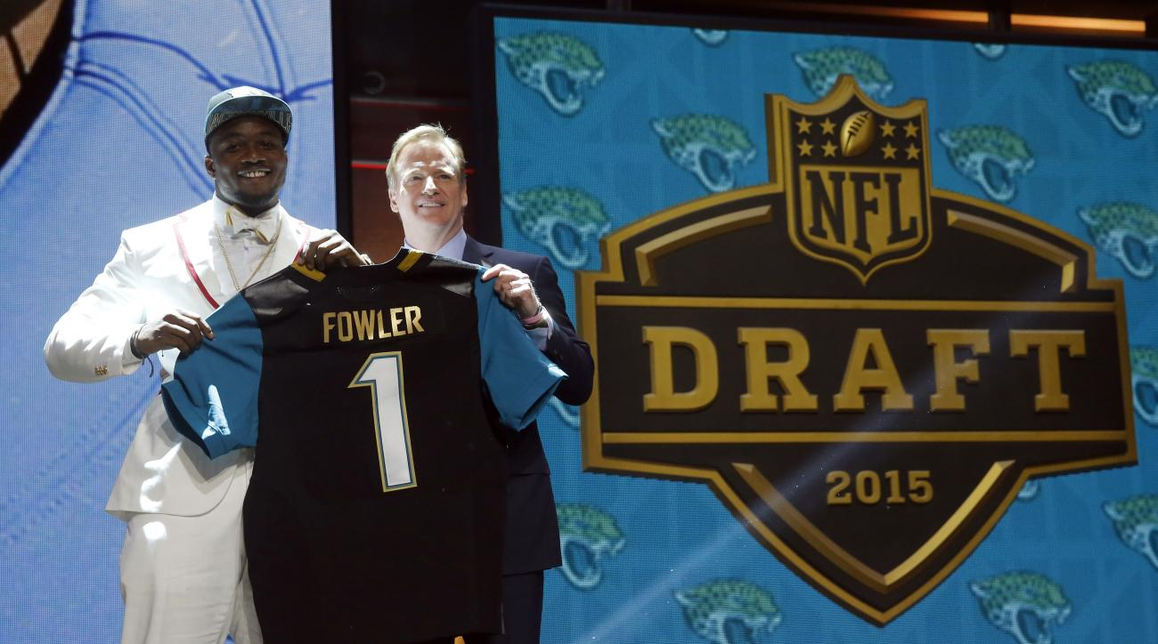 Florida defensive lineman Dante Fowler poses for photos with NFL commissioner Roger Goodell after being selected by the Jacksonville Jaguars as the thrid pick in the first round of the 2015 NFL Draft,  Thursday, April 30, 2015, in Chicago. (AP Photo/Charl