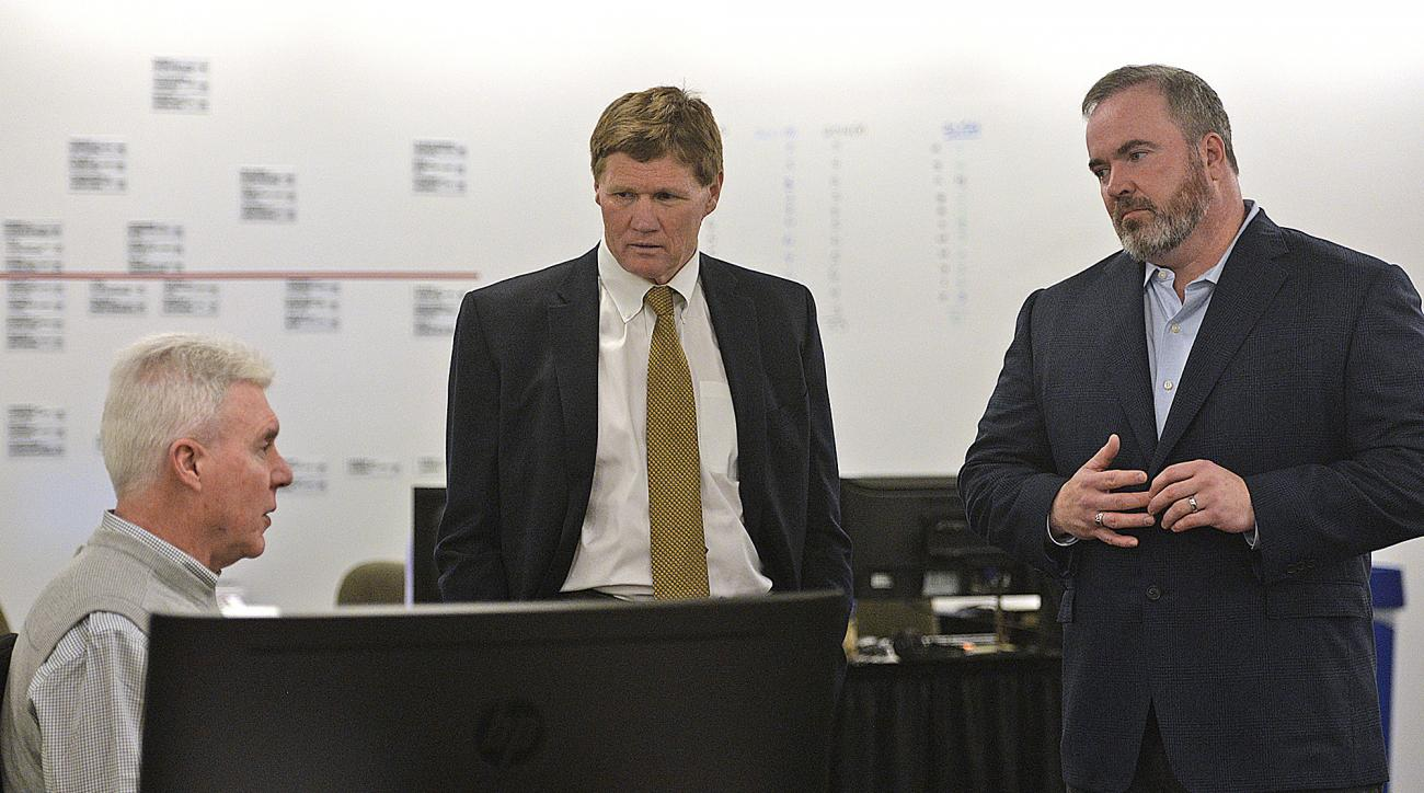 From left, Green Bay Packers general manager Ted Thompson, president Mark Murphy and head coach Mike McCarthy visit with each other inside the war room during the NFL Draft at Lambeau Field in Green Bay, Wis., on Thursday, April 30, 2015. (Evan Siegle/The