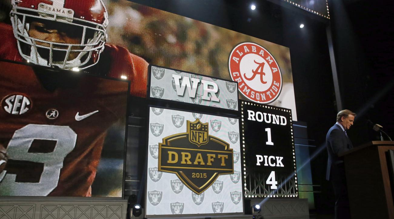 NFL commissioner Roger Goodell announces after the Oakland Raiders selects Alabama wide receiver Amari Cooper as the fourth pick in the first round of the 2015 NFL Draft,  Thursday, April 30, 2015, in Chicago. (AP Photo/Charles Rex Arbogast)