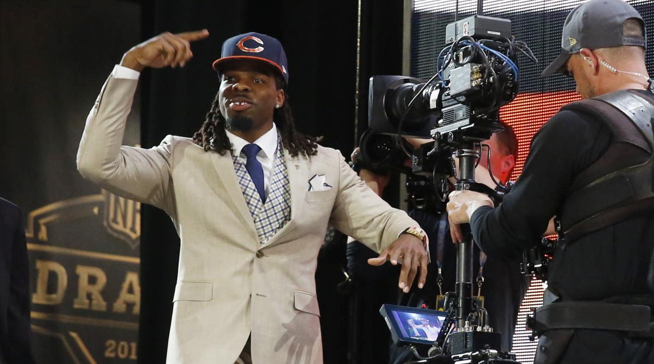 West Virginia wide receiver Kevin White celebrates after being selected by the Chicago Bears as the seventh pick in the first round of the 2015 NFL Draft,  Thursday, April 30, 2015, in Chicago. (AP Photo/Charles Rex Arbogast)