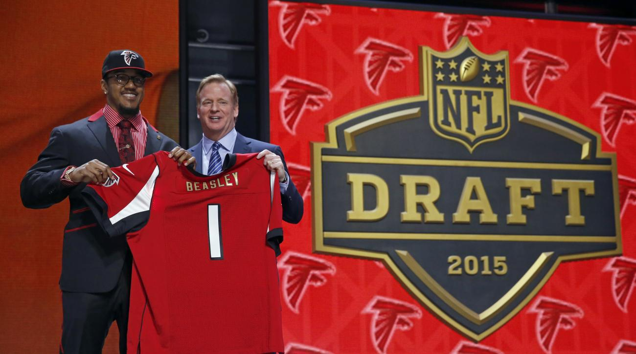 Clemson defensive lineman Vic Beasley poses for photos with NFL commissioner Roger Goodell after being selected by the Atlanta Falcons as the eighth pick in the first round of the 2015 NFL Draft,  Thursday, April 30, 2015, in Chicago. (AP Photo/Charles Re