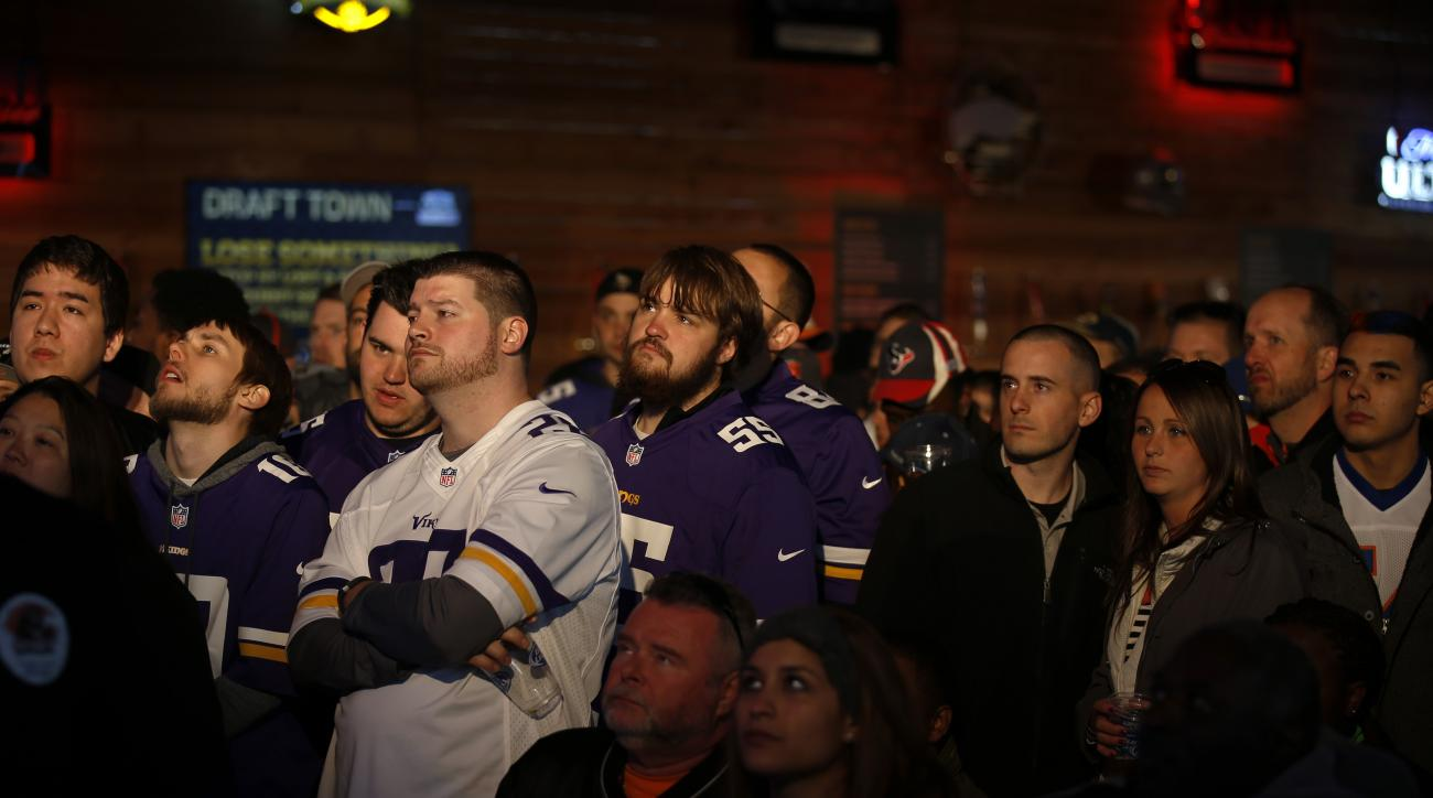 Fans watch a video feed of the 2015 NFL Football Draft inside the Bud Light Draft Tavern at the NFL Draft Town festival Thursday, April 30, 2015, in Chicago. (AP Photo/Andrew A. Nelles)