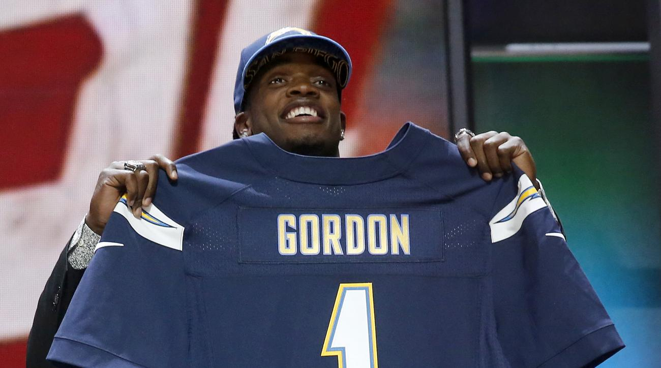 Wisconsin running back Melvin Gordon poses for photos after being selected by the San Diego Chargers as the 15th pick in the first round of the 2015 NFL Draft,  Thursday, April 30, 2015, in Chicago. (AP Photo/Charles Rex Arbogast)
