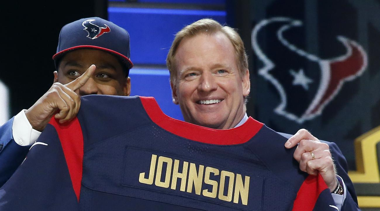 Wake Forest defensive back Kevin Johnson poses for photos with NFL commissioner Roger Goodell after being selected by the Houston Texans as the 16th pick in the first round of the 2015 NFL Draft,  Thursday, April 30, 2015, in Chicago. (AP Photo/Charles Re