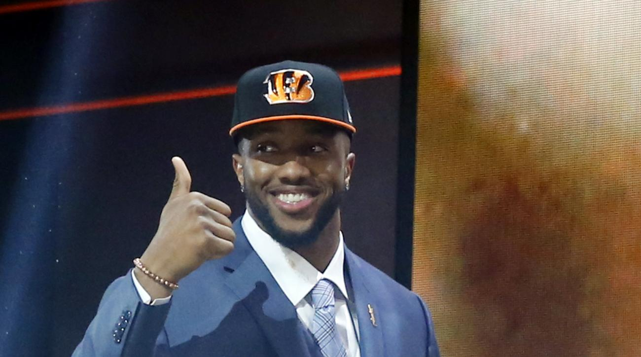 Texas A&M offensive lineman Cedric Ogbuehi celebrates after being selected by the Cincinnati Bengals as the 21st pick in the first round of the 2015 NFL Draft,  Thursday, April 30, 2015, in Chicago. (AP Photo/Charles Rex Arbogast)