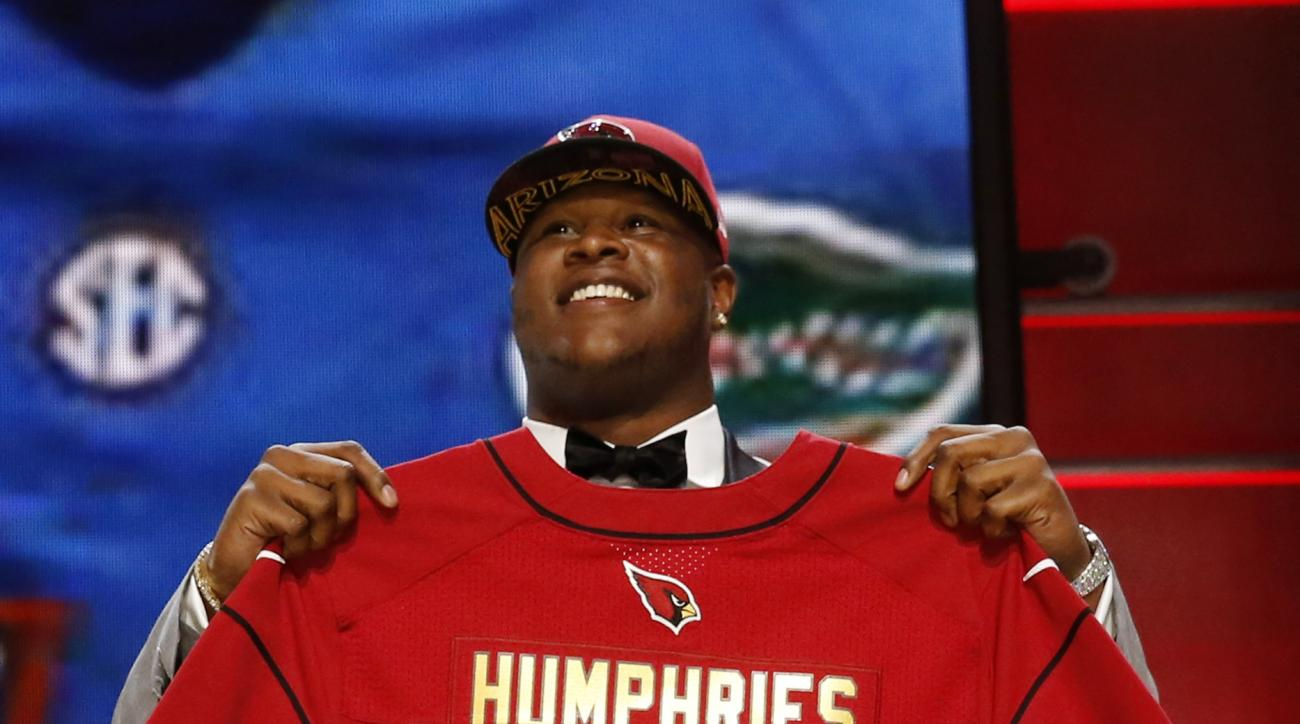 Florida offensive lineman D.J. Humphries poses for photos after being selected by the Arizona Cardinals as the 24th pick in the first round of the 2015 NFL Draft,  Thursday, April 30, 2015, in Chicago. (AP Photo/Charles Rex Arbogast)