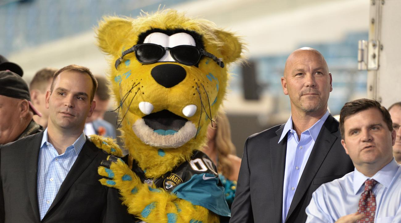 Jacksonville Jaguar's general manager Dave Caldwell, left, and head coach Gus Bradley, wait to take the stage to tell the fans about choosing Florida's Dante Fowler Jr. in the first round of the 2015 NFL draft during the Jacksonville Jaguars NFL draft par