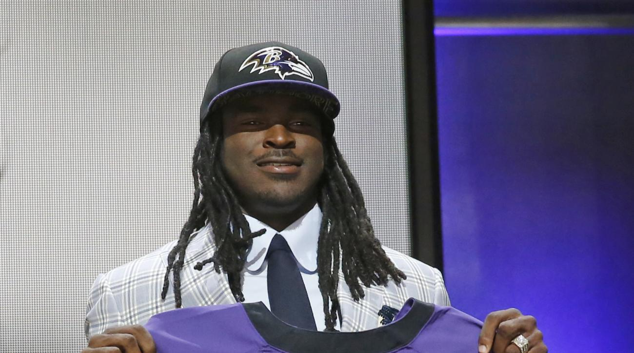 Central Florida wide receiver Breshad Perriman poses for photos after being selected by the Baltimore Ravens as the 26th pick in the first round of the 2015 NFL Draft,  Thursday, April 30, 2015, in Chicago. (AP Photo/Charles Rex Arbogast)