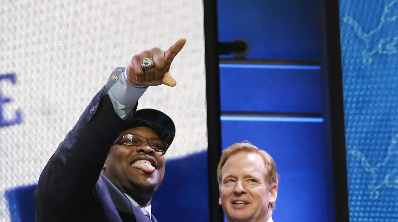 Duke offensive lineman Laken Tomlinson poses for photos with NFL commissioner Roger Goodell after being selected by the Detroit Lions as the 28th pick in the first round of the 2015 NFL Draft,  Thursday, April 30, 2015, in Chicago. (AP Photo/Charles Rex A
