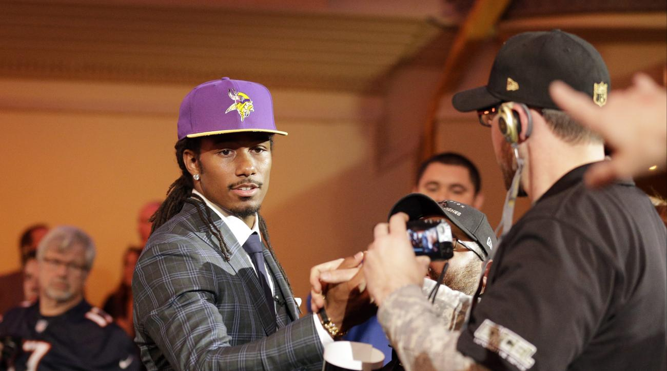 Michigan State defensive back Trae Waynes celebrates with fans after being selected by the Minnesota Vikings as the 11th pick in the first round of the 2015 NFL Football Draft,  Thursday, April 30, 2015, in Chicago. (AP Photo/Nam Y. Huh)